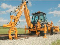 Backhoe Loader - Attachment Systems