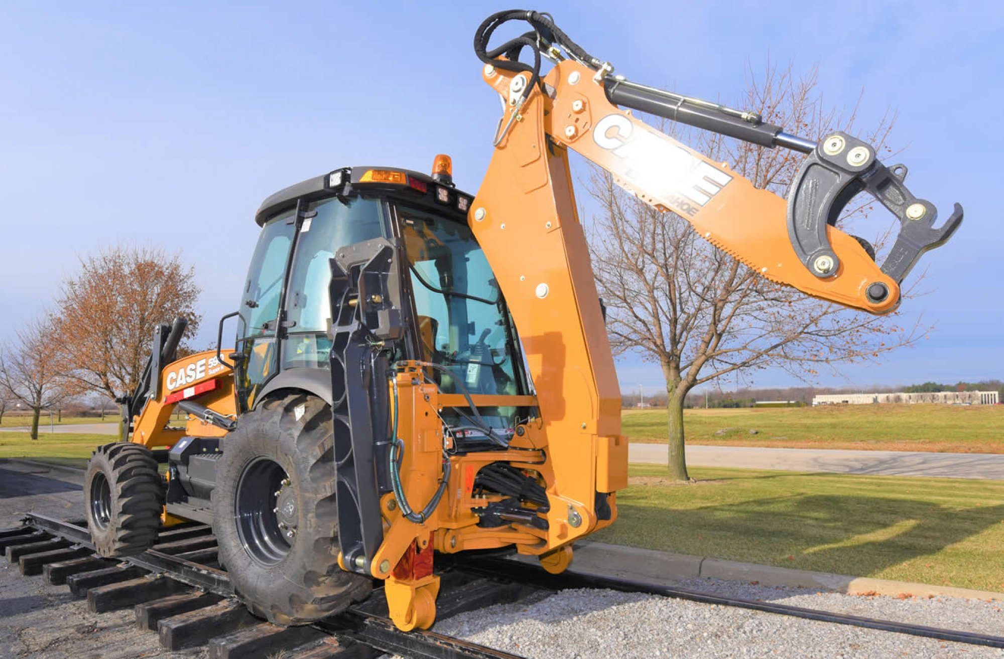 Backhoe Loader - Rail Gear with Wing Down Outriggers
